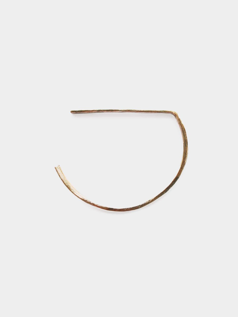 THE MAMA KIN FLAT BANGLE Hand made in the studio in Hungary, the simple Flat bangle from Parallel collection is created of one piece of curved line to achieve playful yet minimal look.