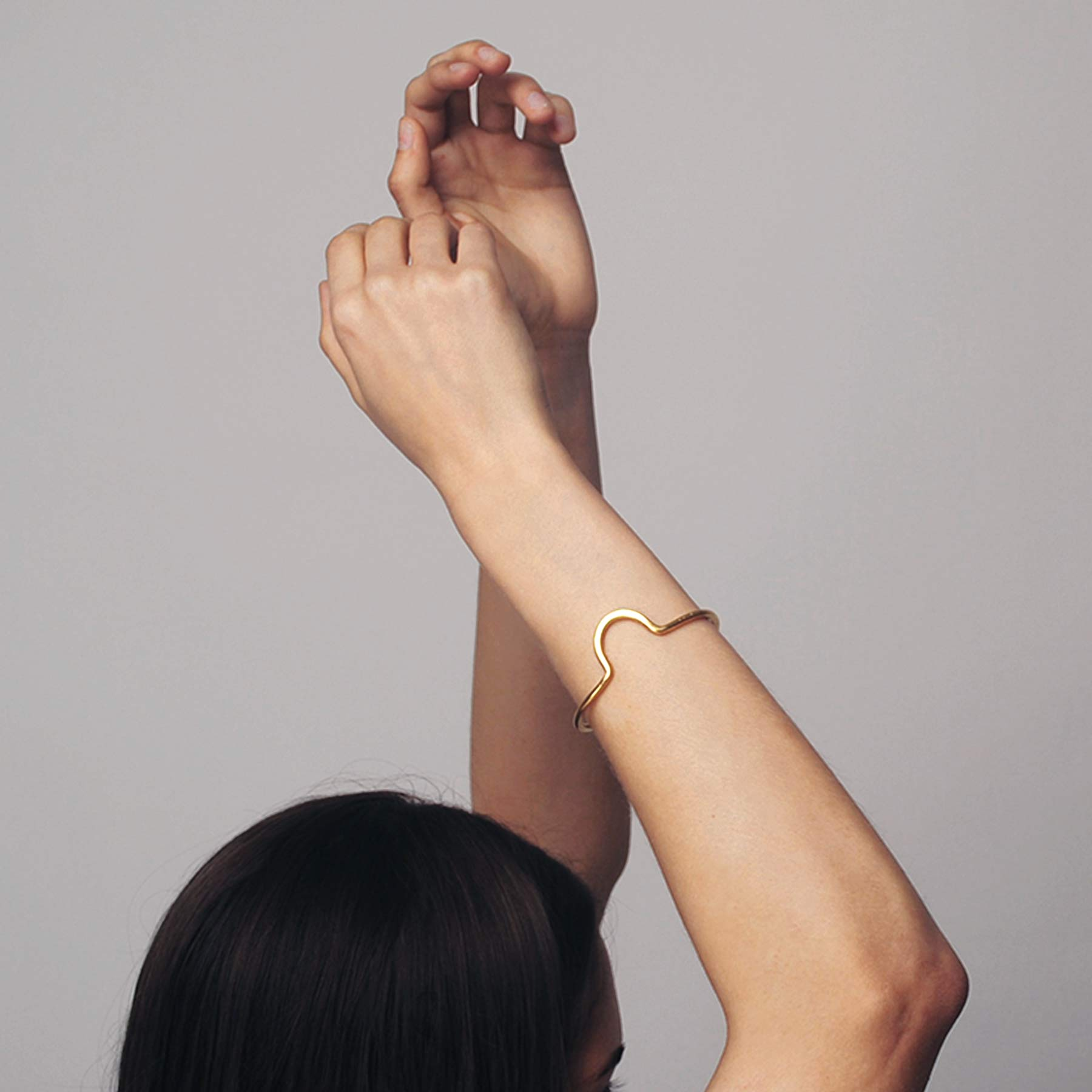 THE MAMA KIN SUNRISE BANGLE Hand made in the Mama Kin studio in Hungary, the simple hammered Sunrise bangle from Solaris collection is created of one piece of curved line with a curve on top to achieve playful yet minimal look.