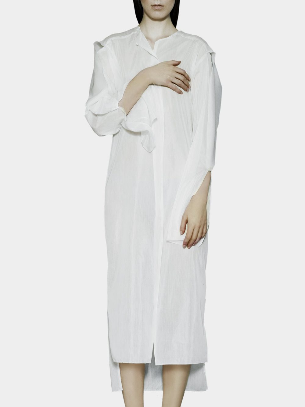 Organisciak's modern refinement of classic silhouettes is apparent in every detail of this breezy transparent tunic, that can be easily worn back to front or belted on one of the sides.